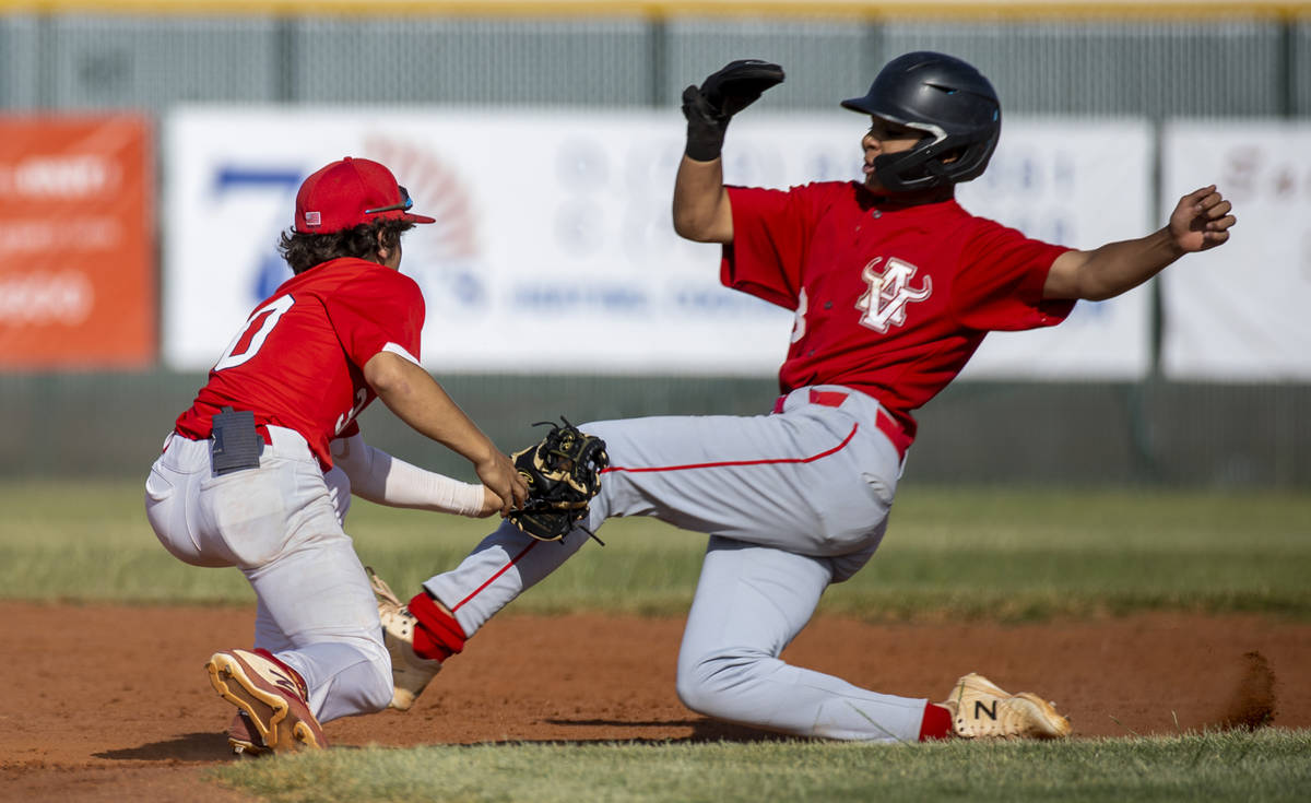 Liberty infielder Dylan Fisher (30) tags out Arbor View runner (3) during the third inning of a ...