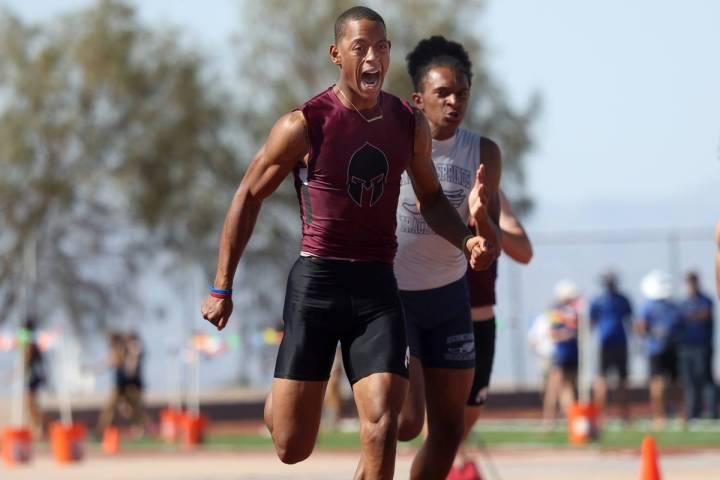 Cimarron-Memorial's Branden Smith wins the Boys 100 meter dash race followed by Canyon Spring's ...