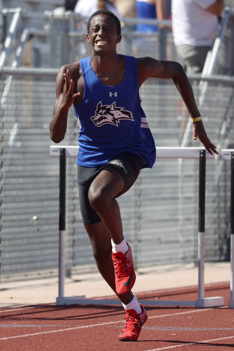 Basic's Jayson Fabiyi wins the Boys 110 meter hurdle race in the Southern Nevada 4a Desert Regi ...