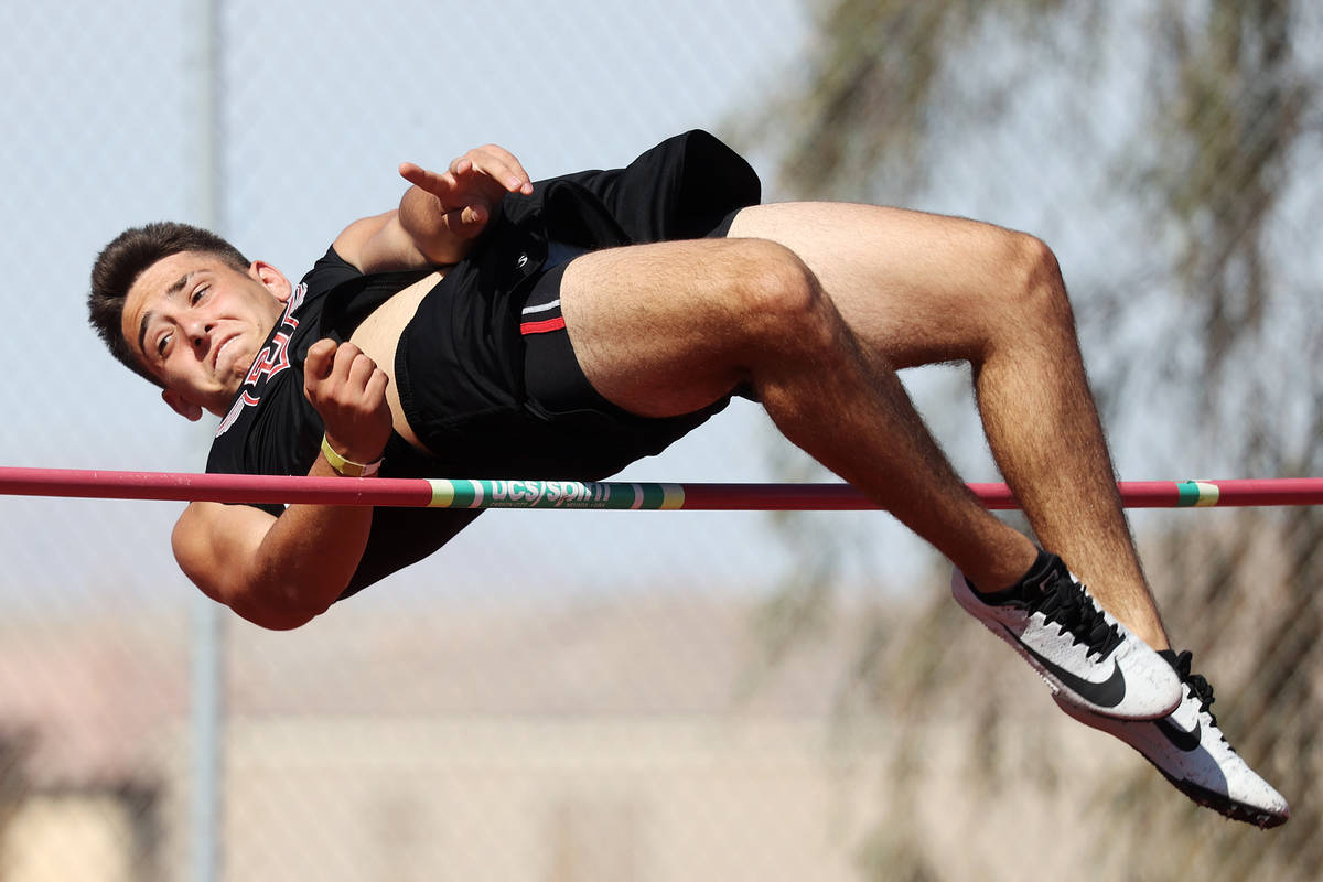 Desert Oasis Caleb Bowman clears the 5-foot-2 bar in the Boys his jump competition during the S ...