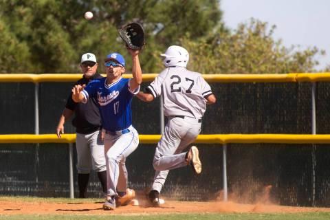Bishop Gorman first baseman Tai Nguyen (17) reaches to catch the ball as Palo Verde's outfielde ...