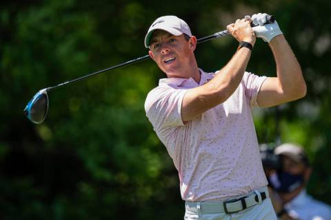 Rory McIlroy tees off on the seventh hole during the fourth round of the Wells Fargo Championsh ...