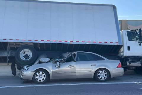 A box truck came to rest on top of a car on U.S. Highway 95 during a two-vehicle collision in t ...