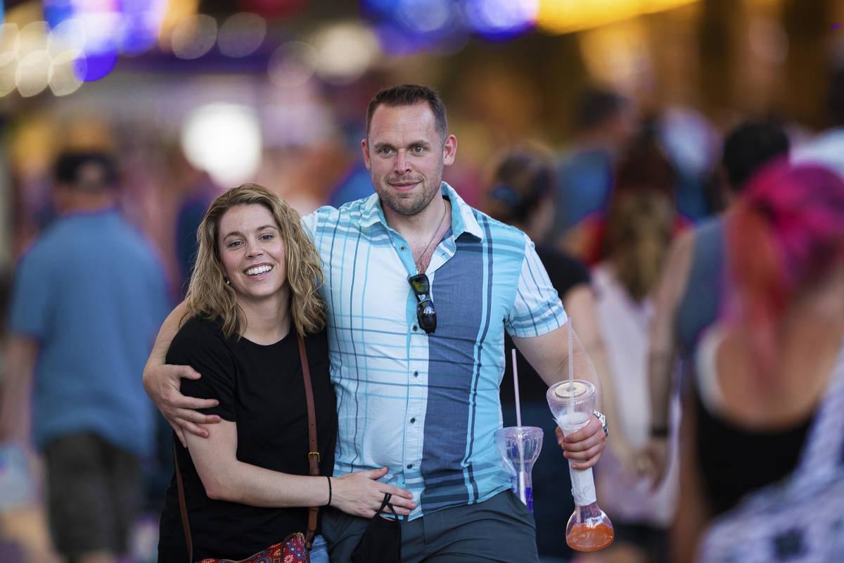 John and Stephanie Rodgers, from Virginia Beach, VA., walk through the Fremont Street Experienc ...