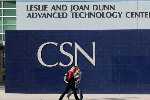 Students walk past the Leslie and Joan Dunn Advance Technology Center at the College of Souther ...
