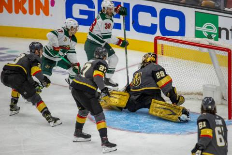 Golden Knights goaltender Marc-Andre Fleury (29) deflects a shot off his chest as Minnesota Wil ...
