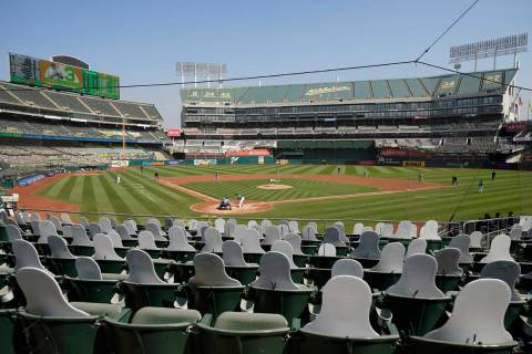 FILE - In this Sept. 30, 2020, file photo, cutouts are seated at Oakland Coliseum as Chicago Wh ...