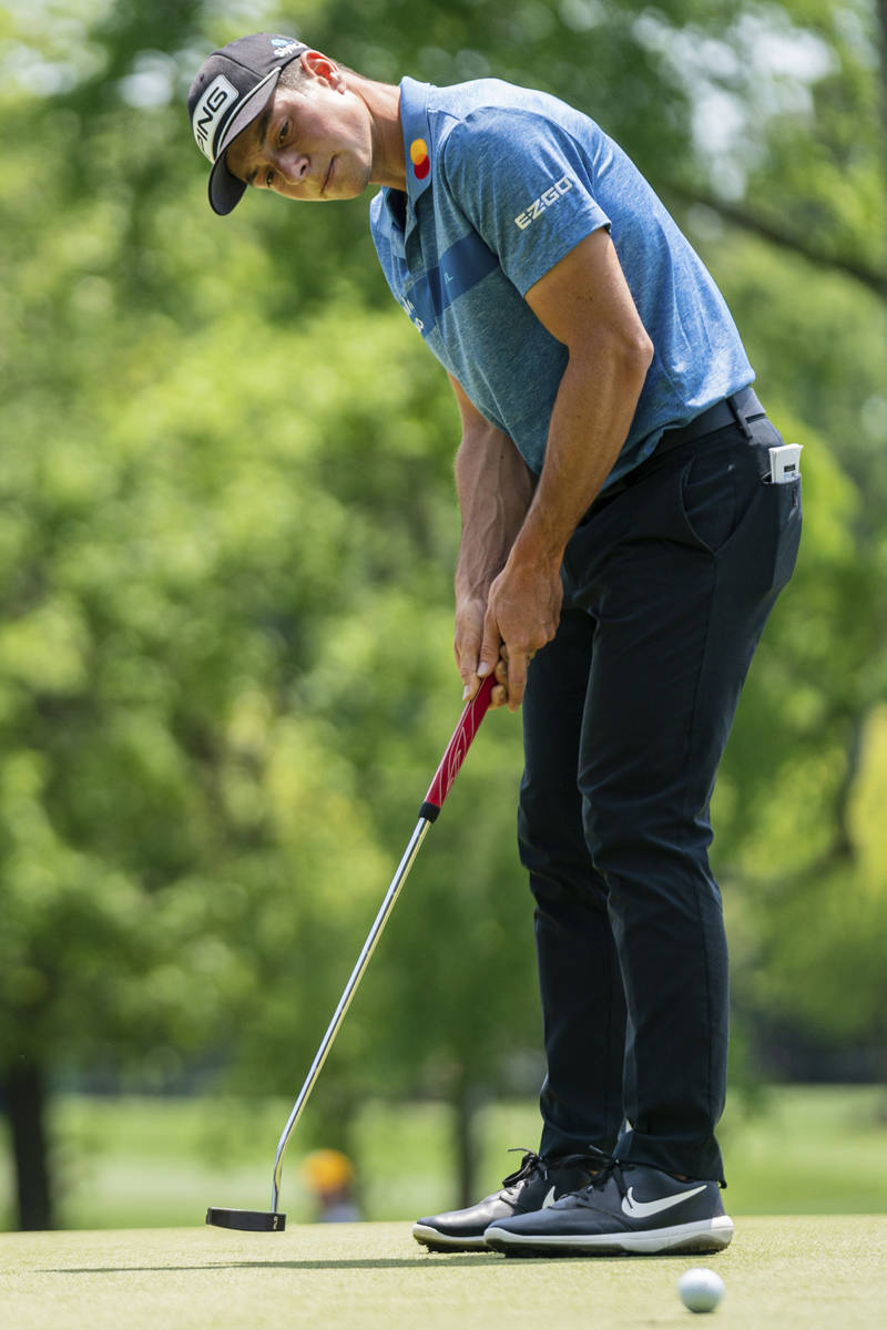 Viktor Hovland putts the ball on the third hole during the fourth round of the Wells Fargo Cham ...