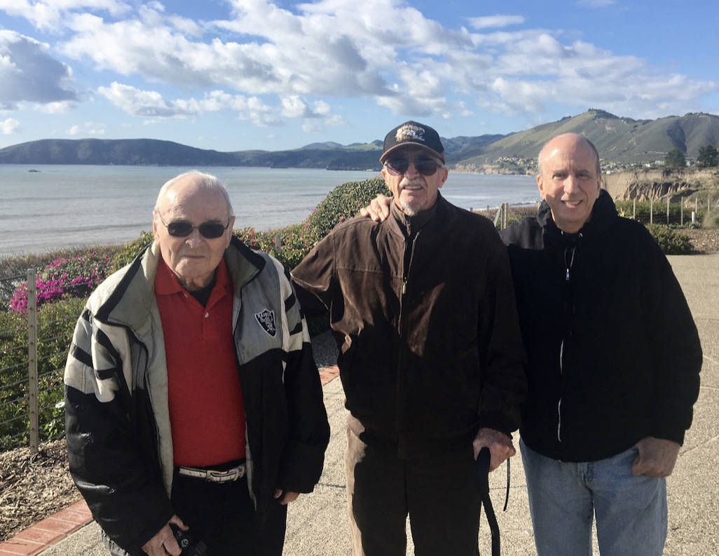 """Retired Marine Peter """"Chris"""" Christoff (center) poses with his longtime friends Bill Cotnam (le ..."""