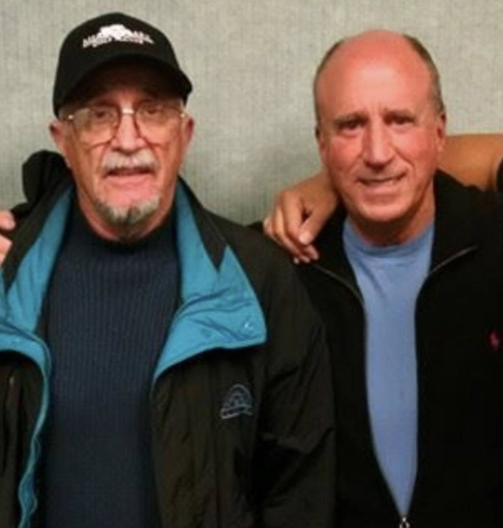 """Retired Marine Peter """"Chris"""" Christoff poses for a picture with his longtime friend Steve Mille ..."""