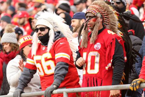 Kansas City Chiefs fans wear headdresses during the first half against the Raiders in Kansas Ci ...