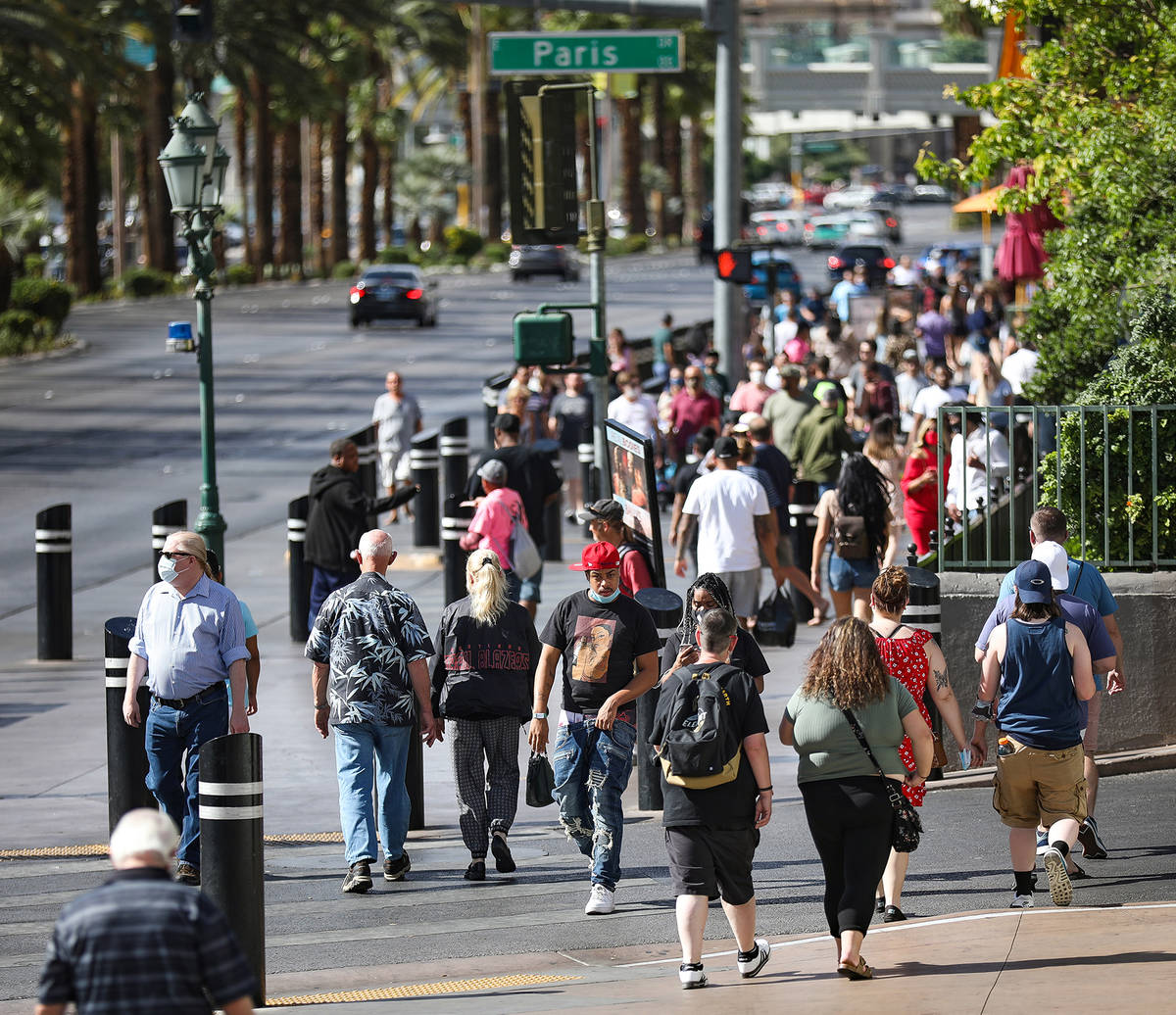 Visitors walk the Strip in Las Vegas, Tuesday, May 25, 2021. (Rachel Aston/Las Vegas Review-Jou ...