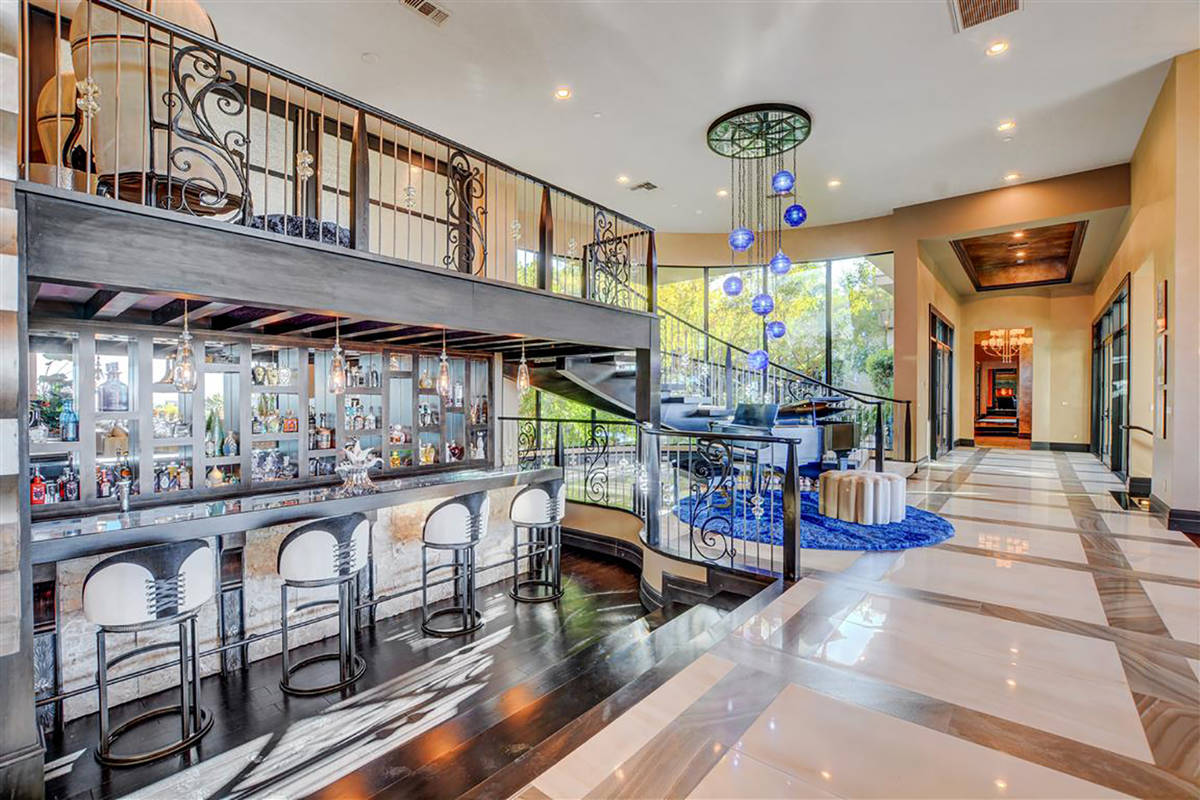 A long bar lines the great room. (Keller Williams)
