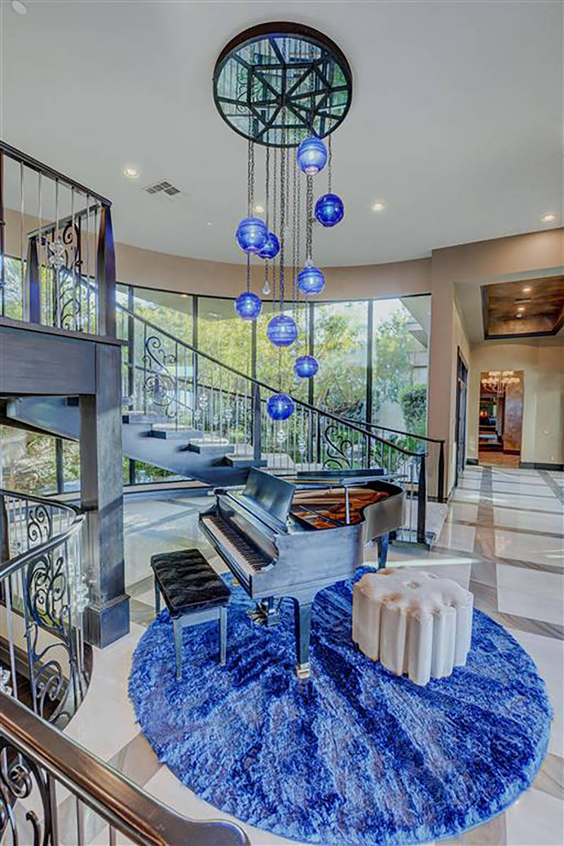 The home features a blue chandelier by Santangelo. (Keller Williams)