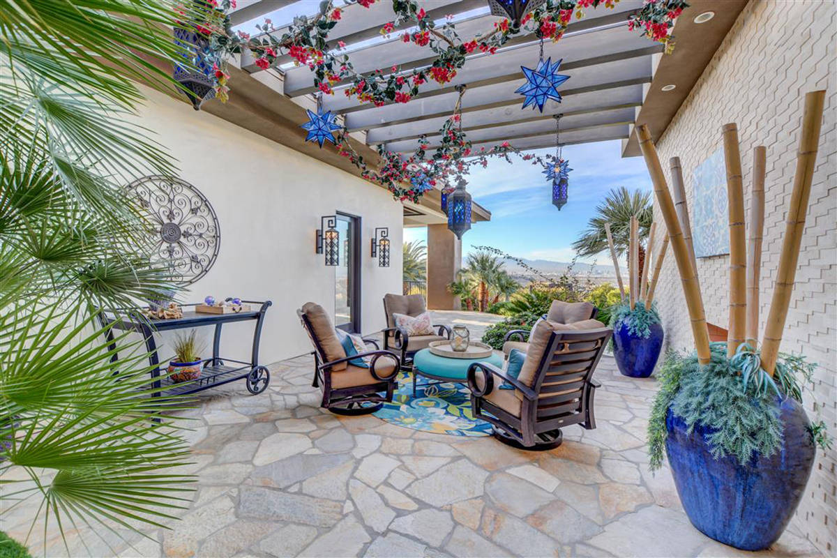 Patio opens to one of two pools. (Keller Williams)