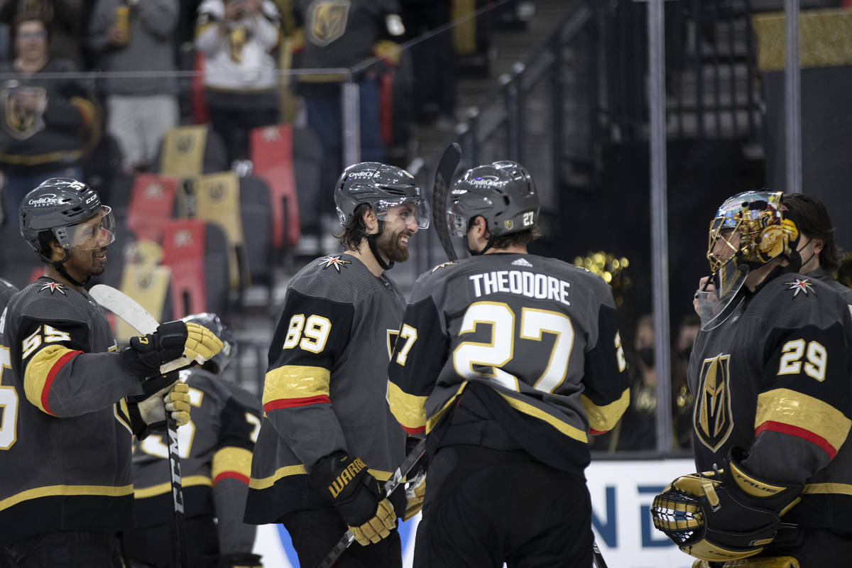 The Golden Knights celebrate their win against the Wild, including right wing Alex Tuch (89), c ...