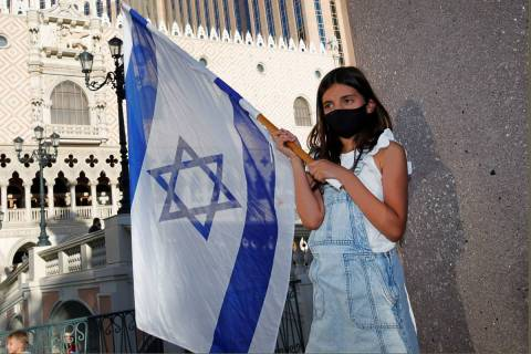 Ellyah Arbeli, 8, holds an Israeli flag during a rally in support of Israel outside The Venetia ...