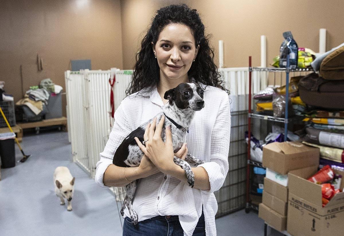 Francesca Fulciniti, executive director of Heaven Can Wait Animal Society, holds Nina as she po ...