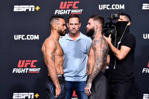 Rob Font, left, and Cody Garbrandt face off during the UFC Fight Night weigh-in at UFC APEX on ...