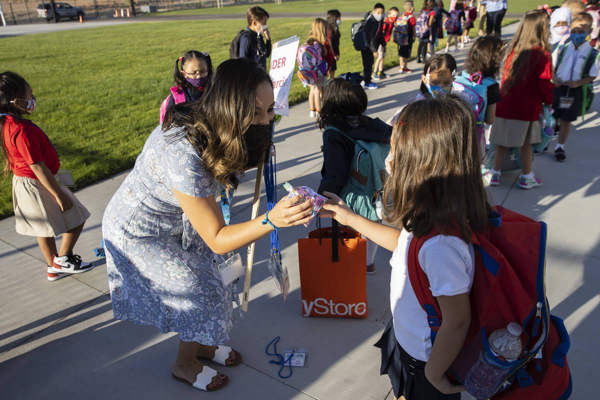 Mercedes Garcia, kindergarten teacher, receives a gift from her student, Alisea Nikolova, 5, at ...