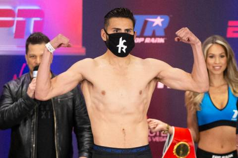 Jose Ramirez poses on the scale during a weigh-in at the Virgin Hotel in Las Vegas, Friday, May ...