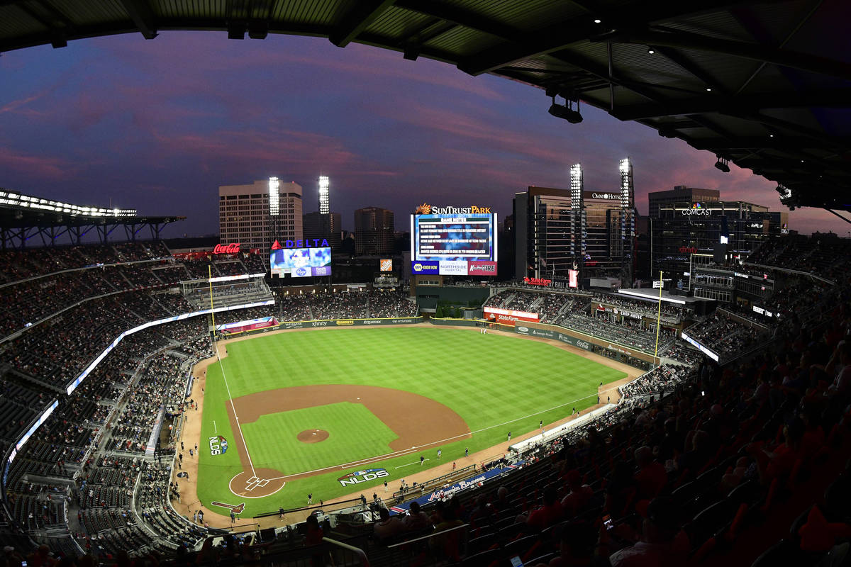 FILE - In this Oct. 7, 2018, file photo, ground crews prepare the field at Sun Trust Park, now ...
