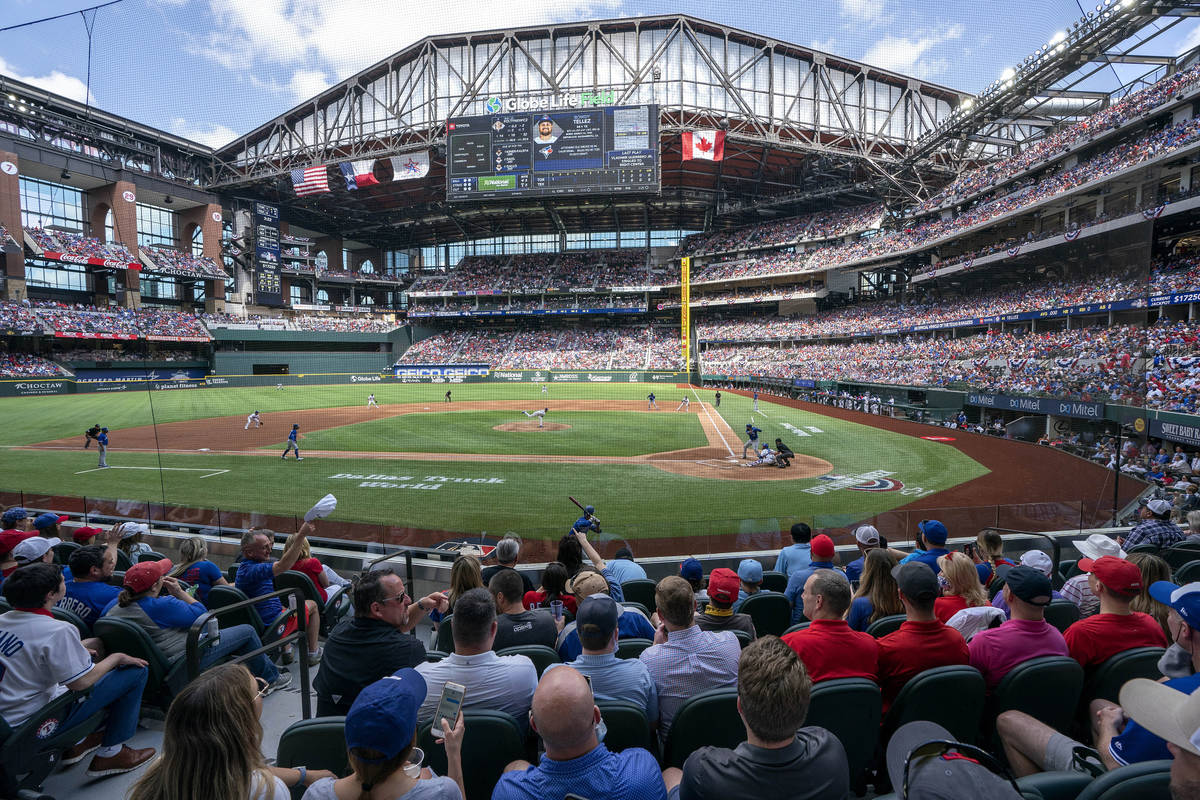 Fans fill the stands at Globe Life Field during the first inning of a baseball game between the ...