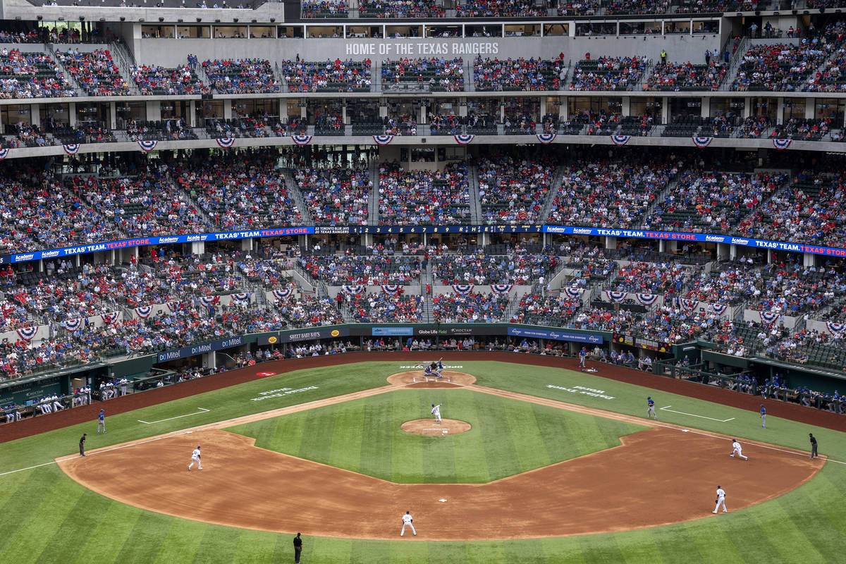 Fans fill the stands at Globe Life Field during the second inning of a baseball game between th ...