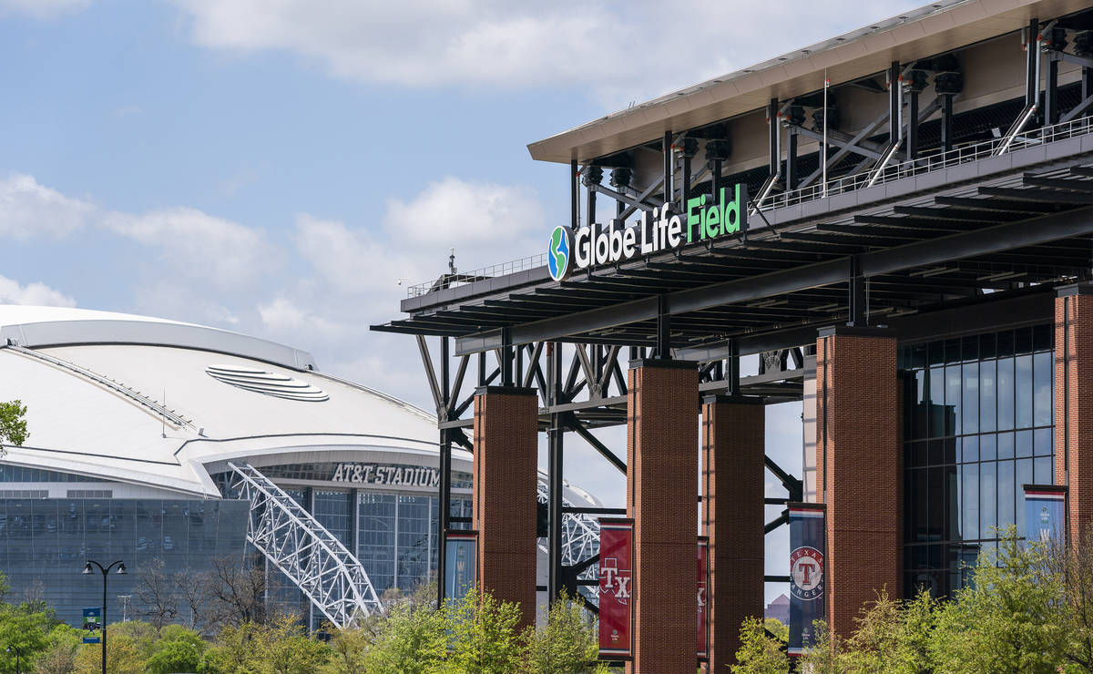 The facade of Globe Life Field stands in front of the Dallas Cowboys' AT&T Stadium before a ...