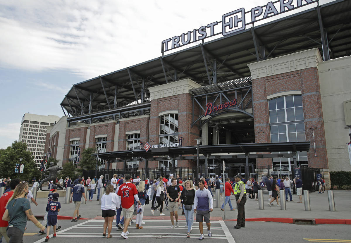 Fans make their way into Truist Park for the baseball game between the Atlanta Braves and the P ...