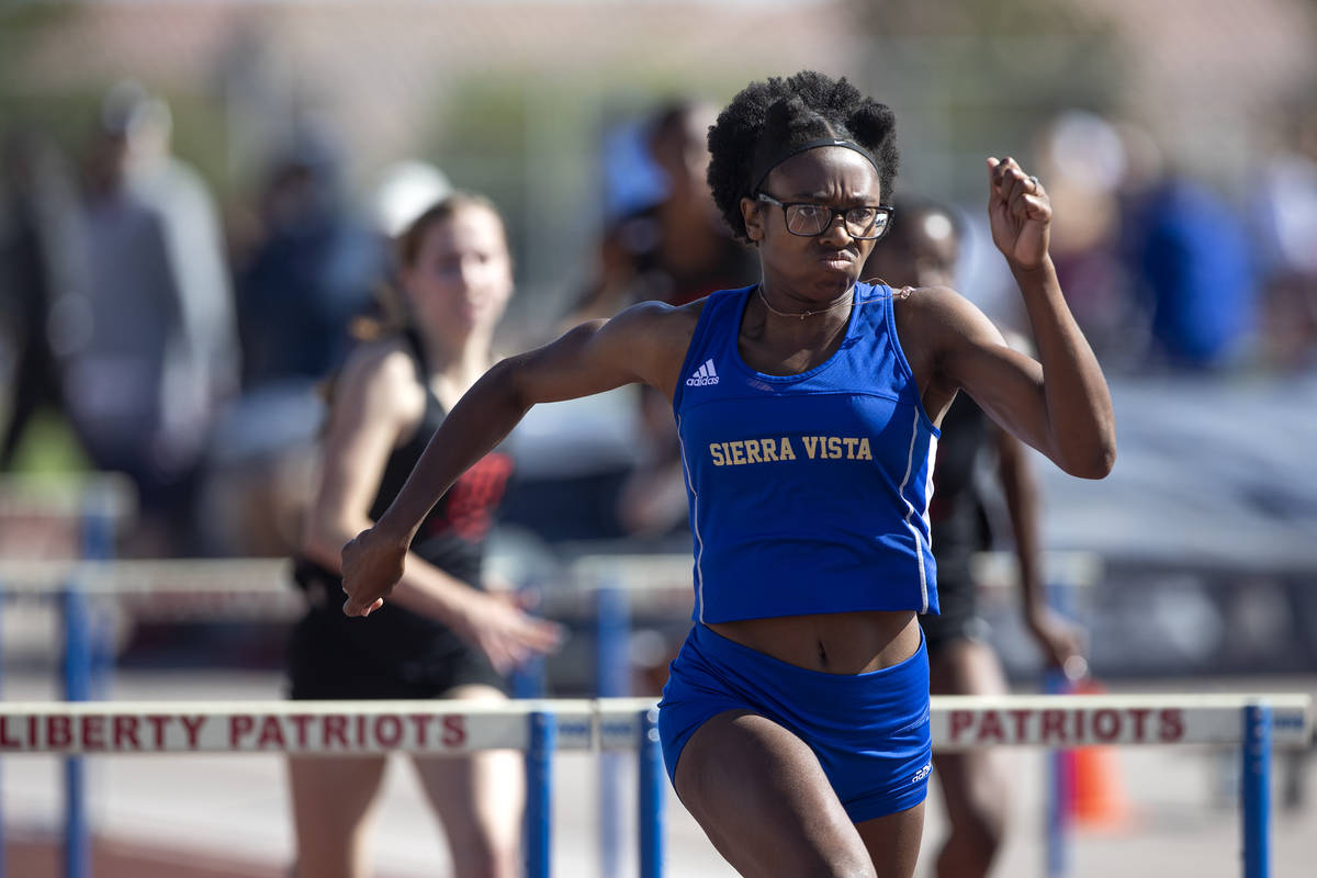 Sierra Vista's Ajanae Cressey, second from left, competes in the girls 100 hurdles final race d ...