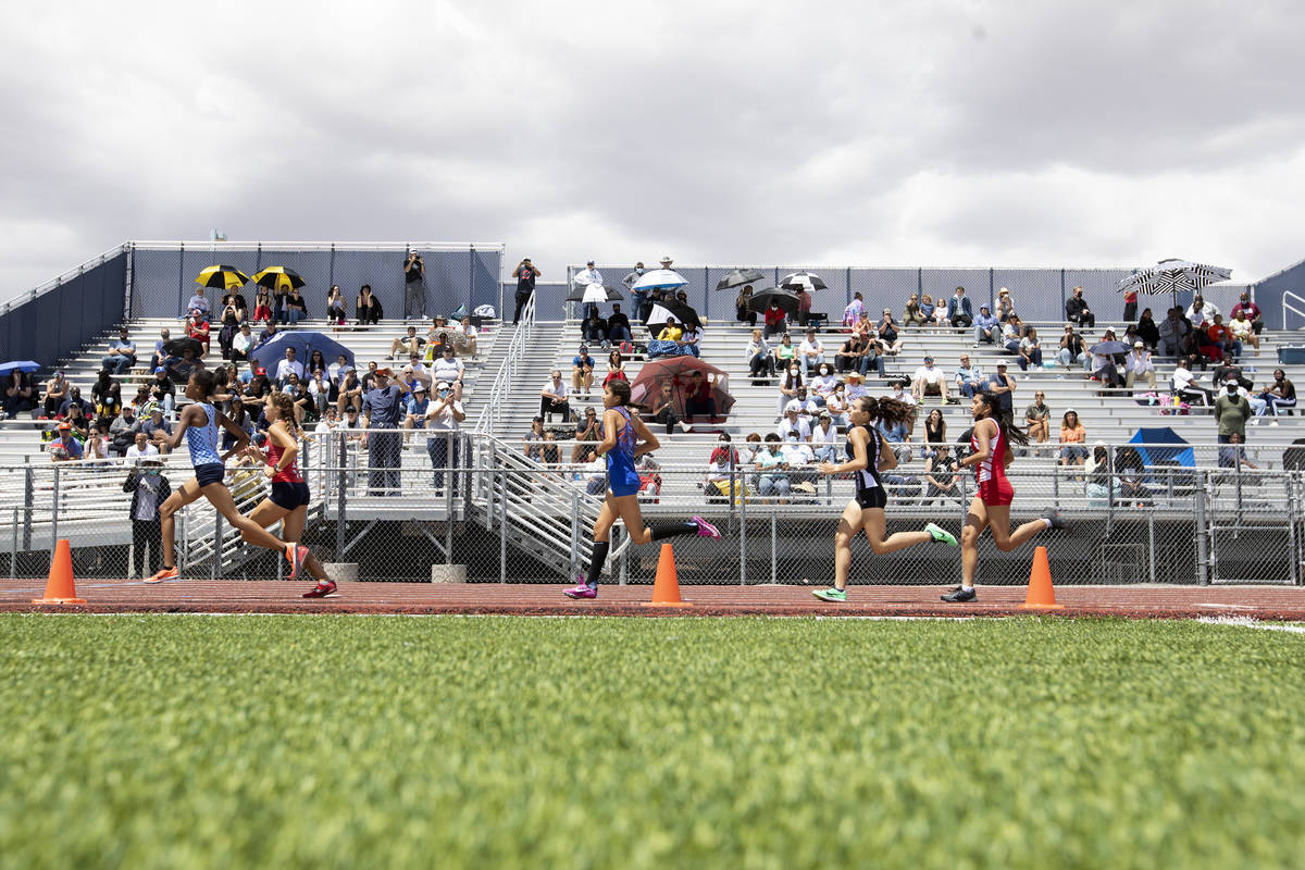 Runners compete in the girls 400 meter dash during the class 5A Southern Region boys and girls ...