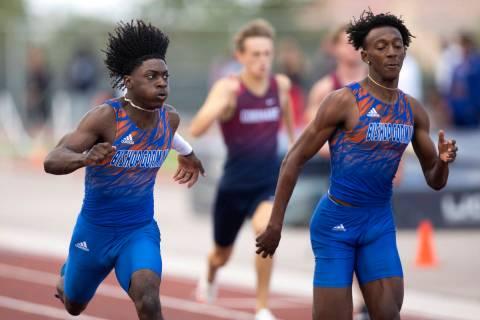 Bishop Gorman's Zachariah Branch, left, and Maleik Pabon compete in the boys 200 meter dash dur ...