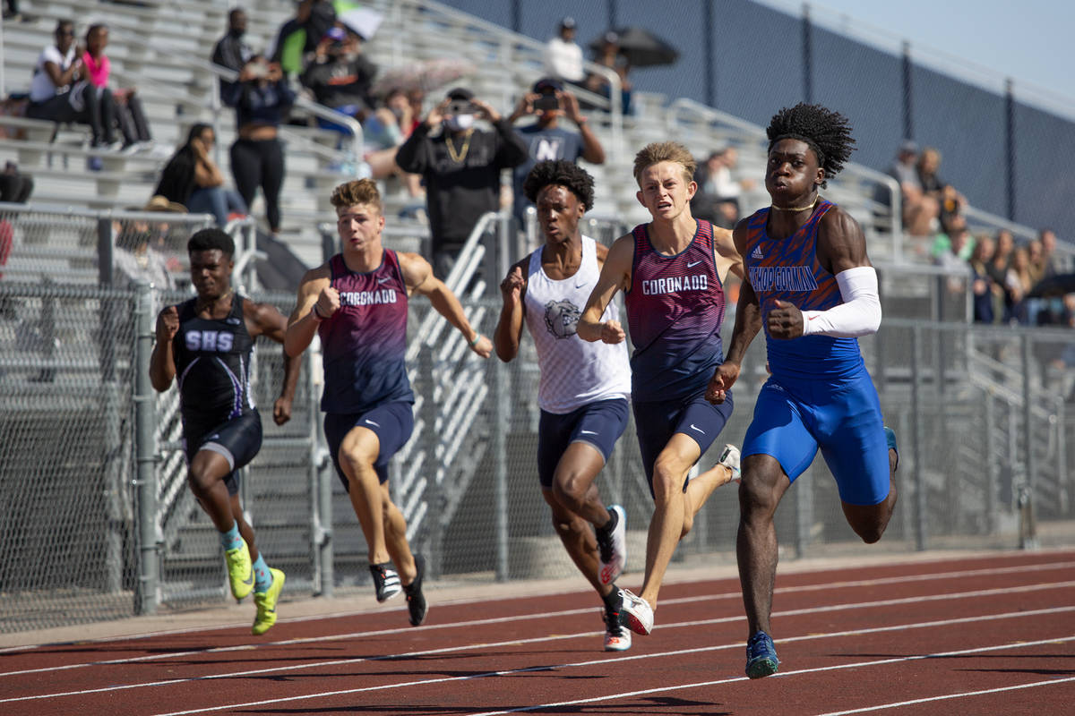Bishop Gorman's Zachariah Branch, right, runs the boys 100 meter dash, and wins, during the cla ...