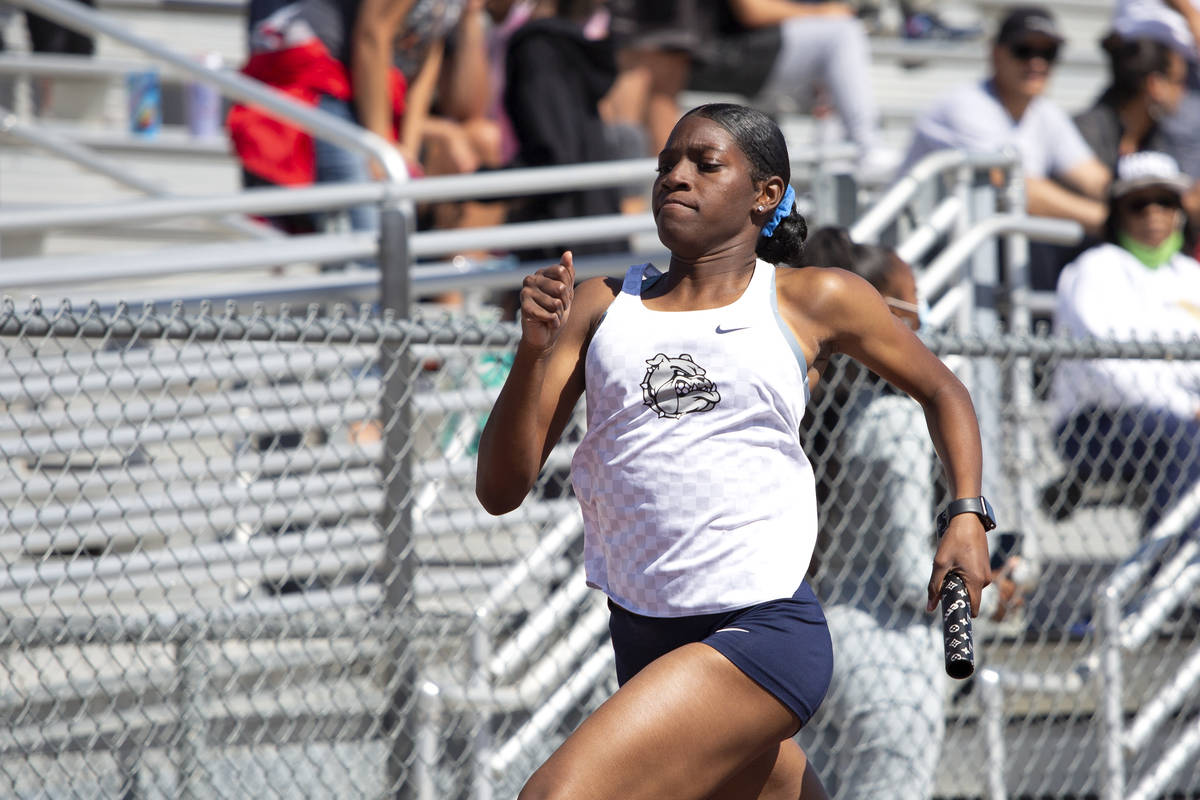 Centennial's Iyonna Codd competes in the girls 4x200 meter relay race during the class 5A South ...