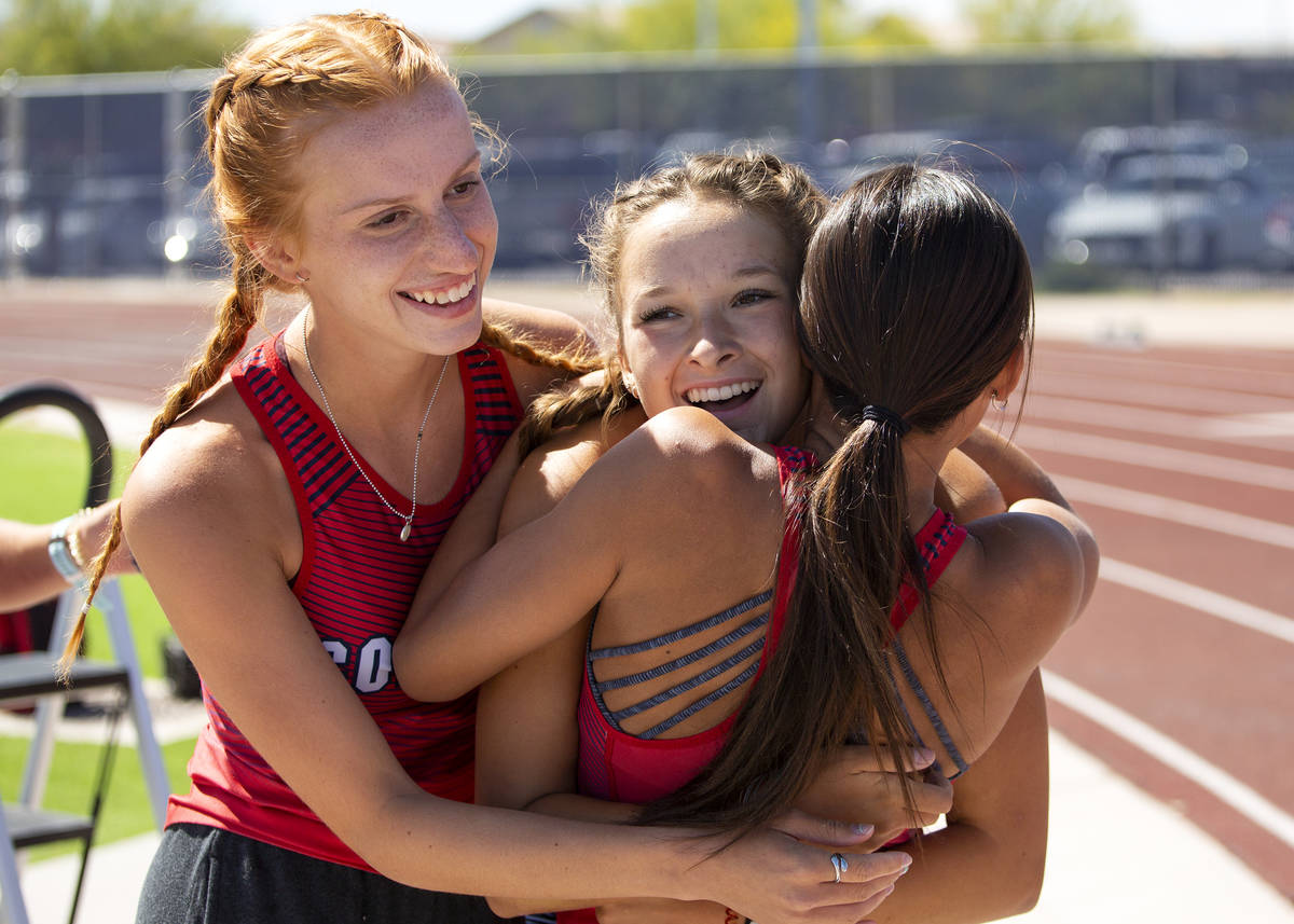 Coronado's Erin Shannon, center, is hugged by her teammates after winning the girls 800 meter r ...