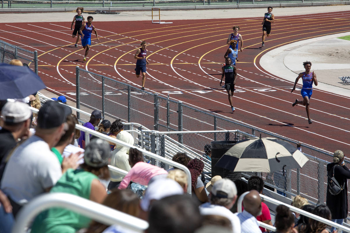 Bishop Gorman's Maleik Pabon leads the pack in the boys 400 meter race during the class 5A Sout ...
