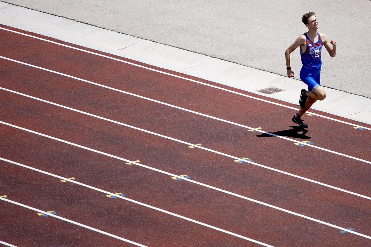 Bishop Gorman's Andrew Specht pushes toward a win and the finish line during the class 5A South ...