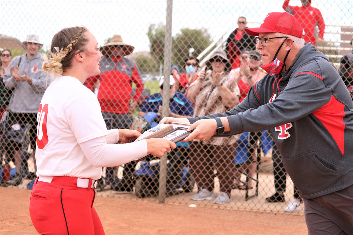 Arbor View athletic director Jay Howard hands the Class 5A Southern Region tournament champions ...