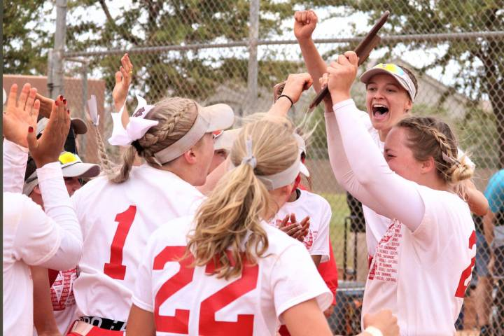 Arbor View pitcher Annie Finch (with trophy) joins her teammates to celebrate after the Aggies ...
