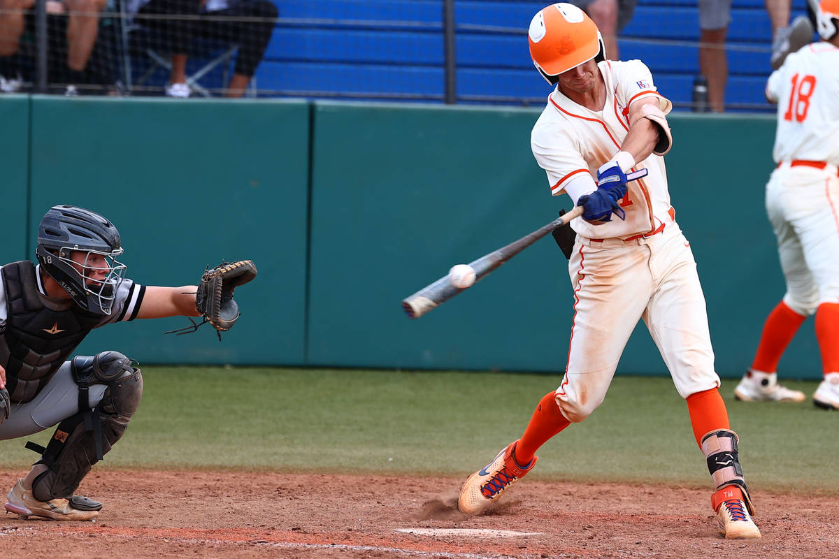 Bishop Gorman High's right fielder Tyler Whitaker connects with the ball against Palo Verde dur ...