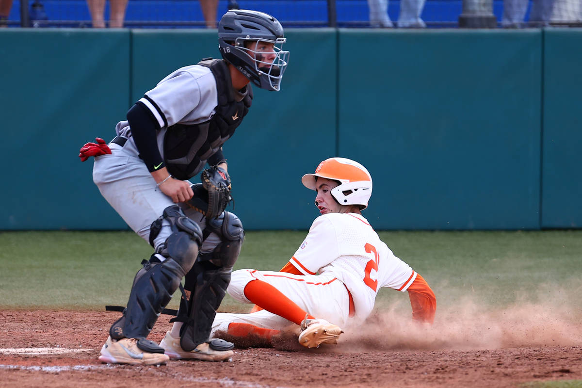 Bishop Gorman High's outfielder Tommy Rose scores as Palo Verde's catcher Aric Anderson waits f ...