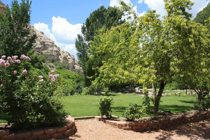 Mature perennial gardens and lush vegetation are made possible by the nine natural springs in t ...