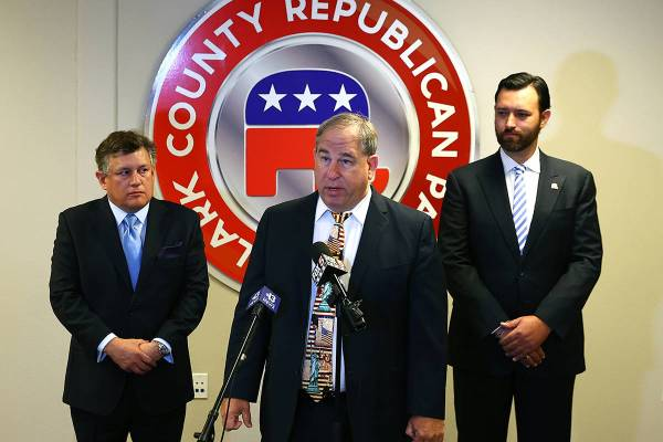 Clark County Republican Party Chairman David Sajdak, center, speaks during a press conference a ...