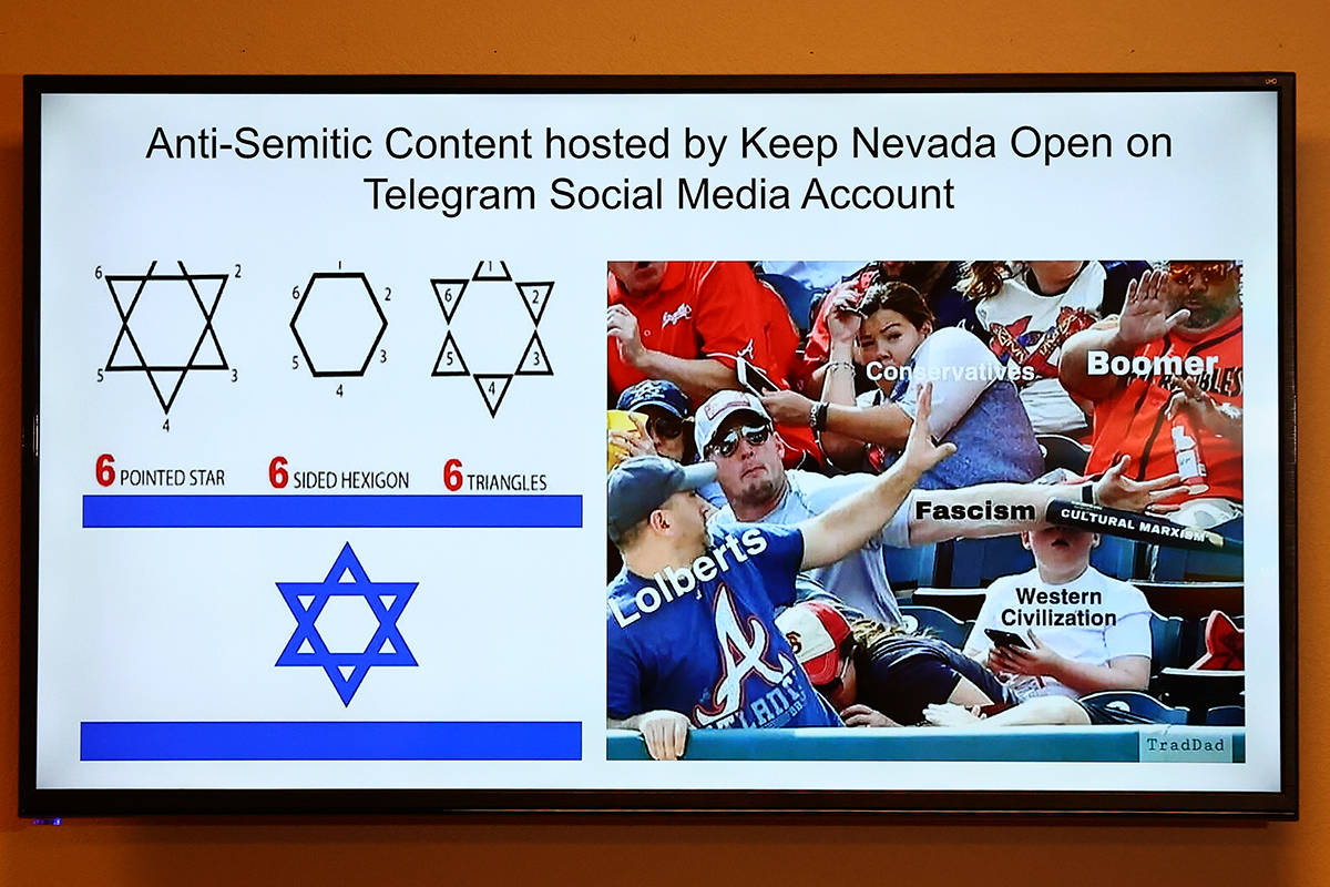 A video of Anti-Semitic content hosted by Keep Nevada Open on social media is played during a p ...