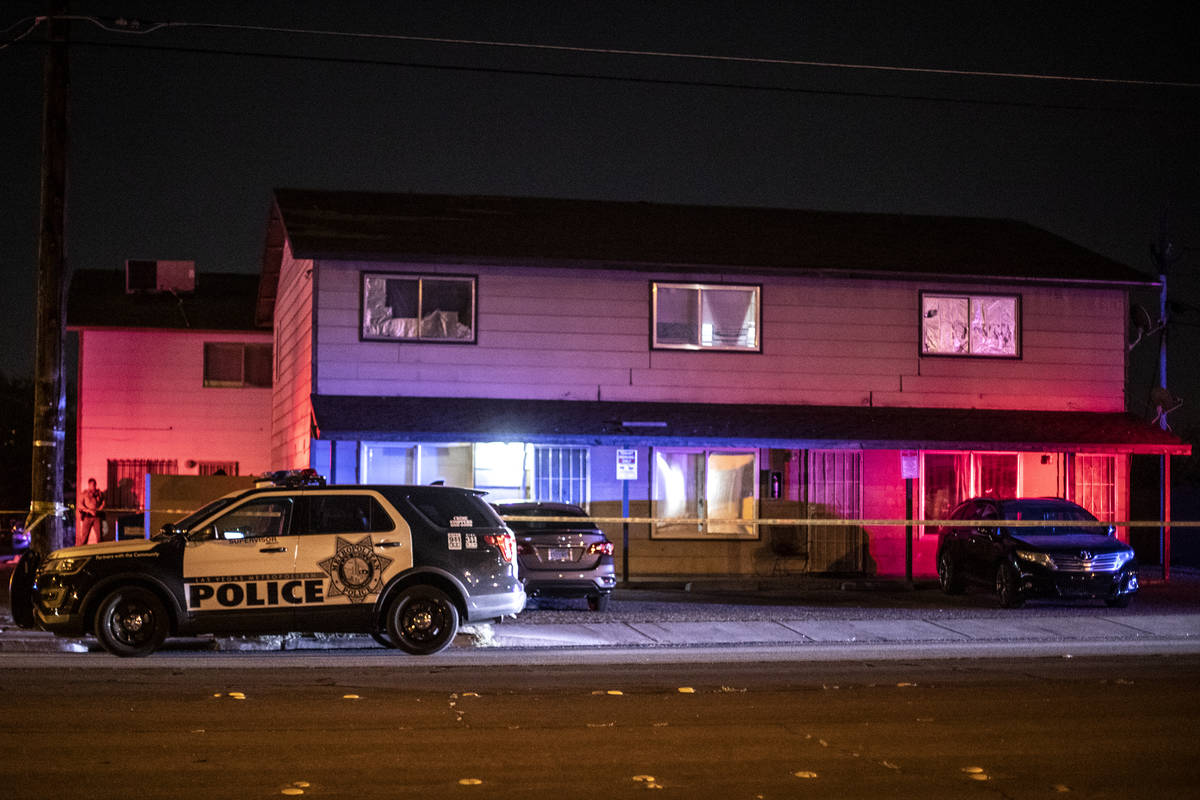 Metropolitan police investigate a homicide on the 3400 block of Center Drive, near East Charles ...