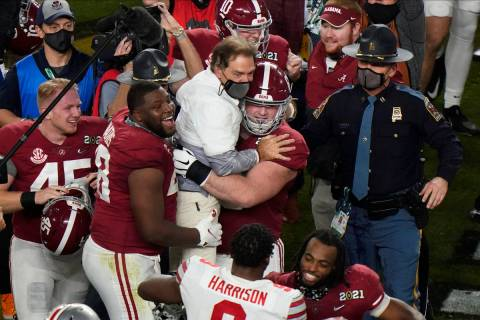 Players celebrate with Alabama head coach Nick Saban after their win against Ohio State in an N ...