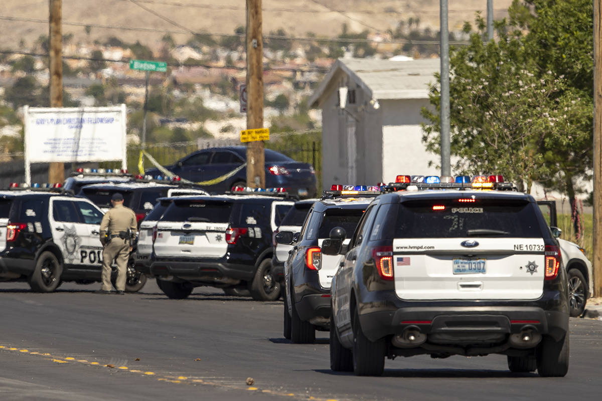Metro officers and military personnel arrive while being staged for a Nellis Air Force Base jet ...