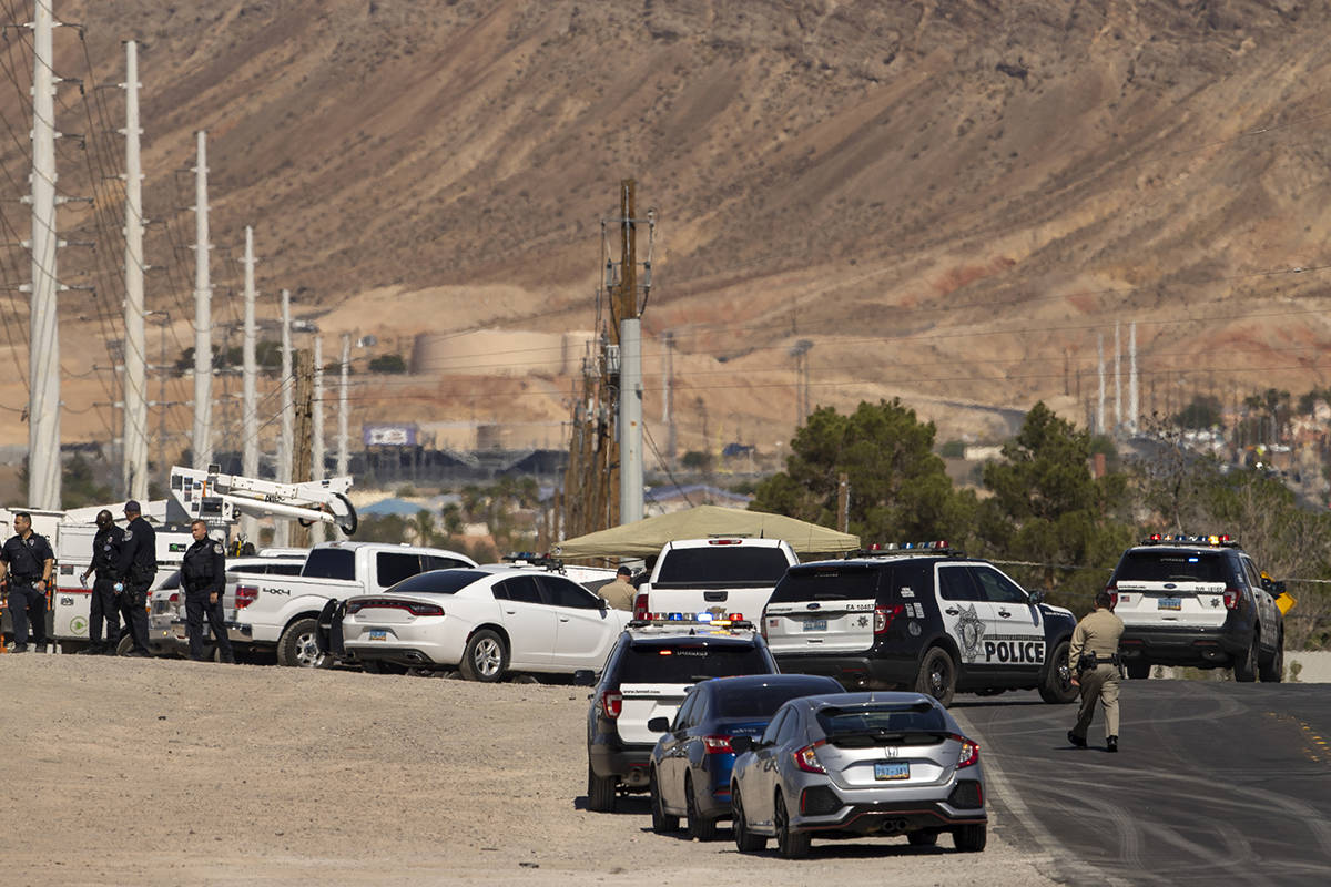Metro officers and military personnel are staged for a Nellis Air Force Base jet crash on E. Ca ...