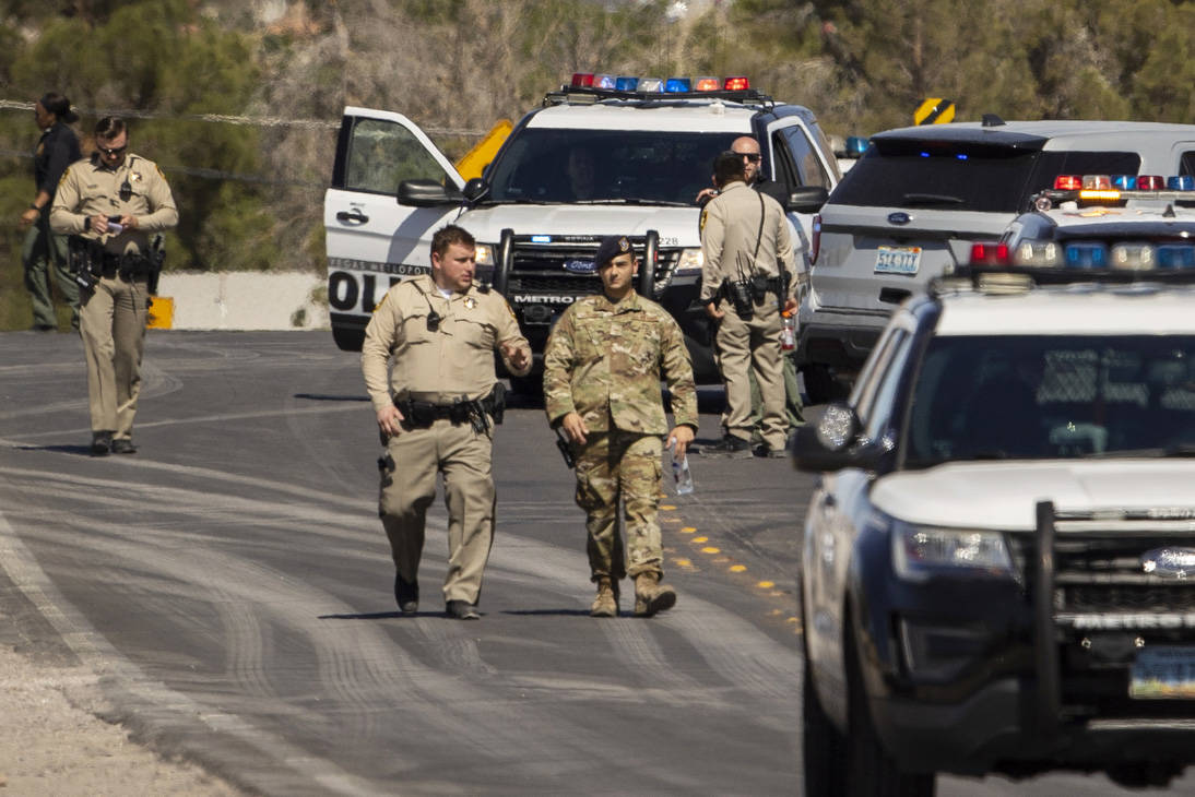 Metro officers and military personnel are move about as they stage for a Nellis Air Force Base ...